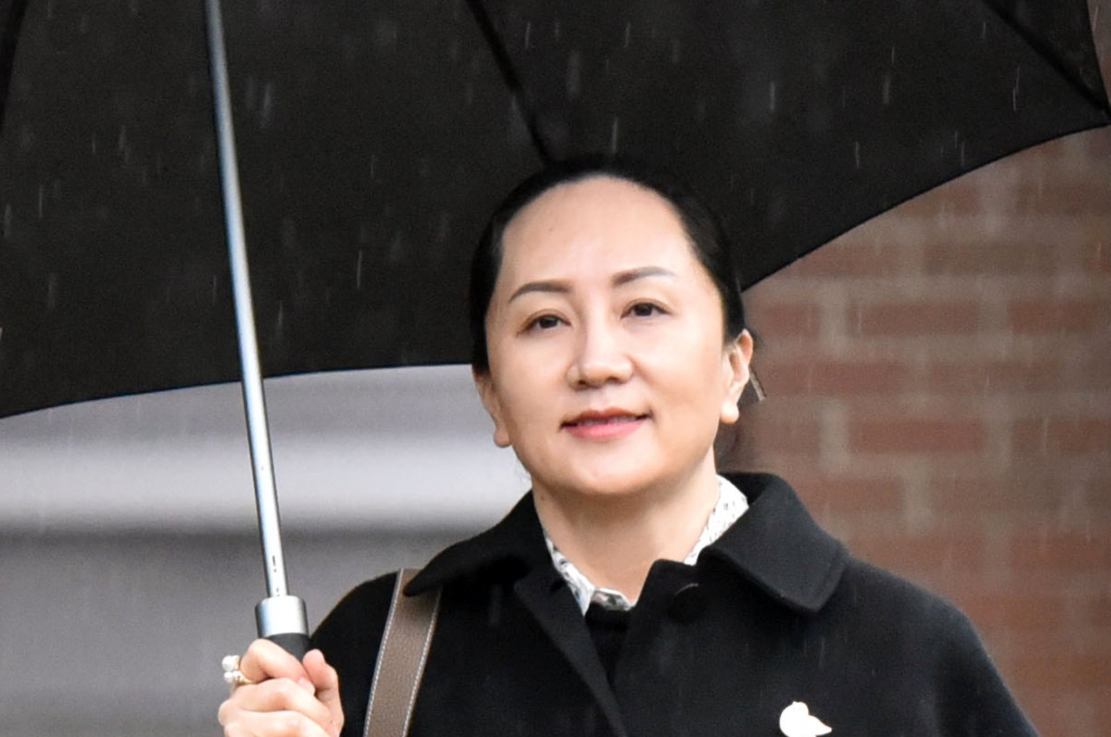 In this file photo taken on Jan. 23, 2020, Huawei chief financial officer Meng Wanzhou leaves her Vancouver home to go to her extradition hearing in British Columbia Supreme Court in Vancouver, British Columbia. (AFP Photo)