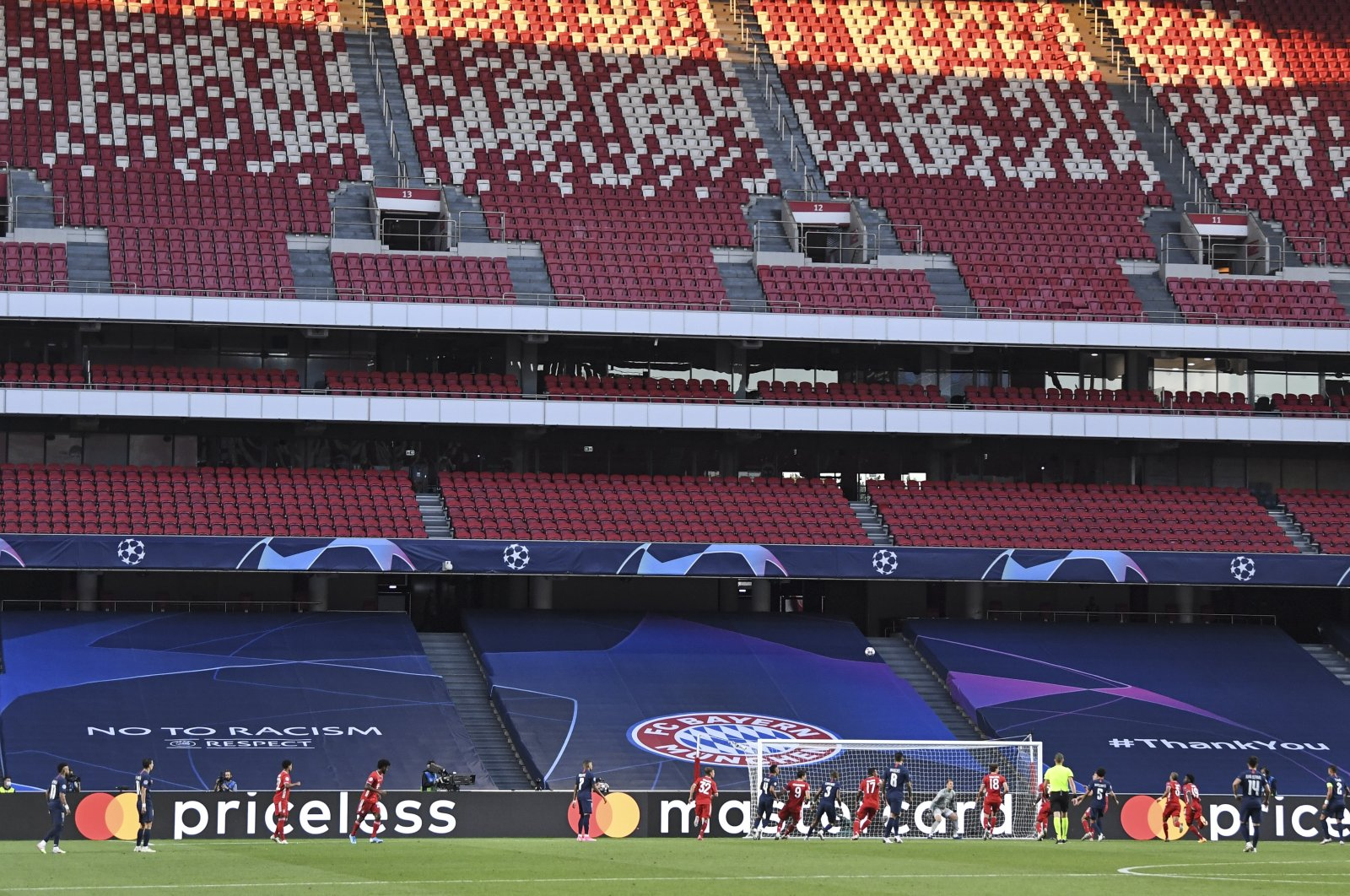 Players challenge for the ball in front of empty stands during the Champions League final match between Paris Saint-Germain and Bayern Munich in Lisbon, Portugal, Aug. 23, 2020. (AP Photo)