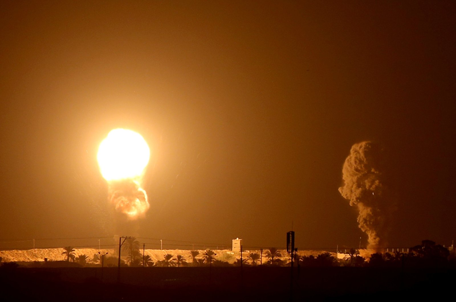 Smoke and flame are seen following an Israeli air strike in the southern Gaza Strip, Sept. 16, 2020. (REUTERS Photo)