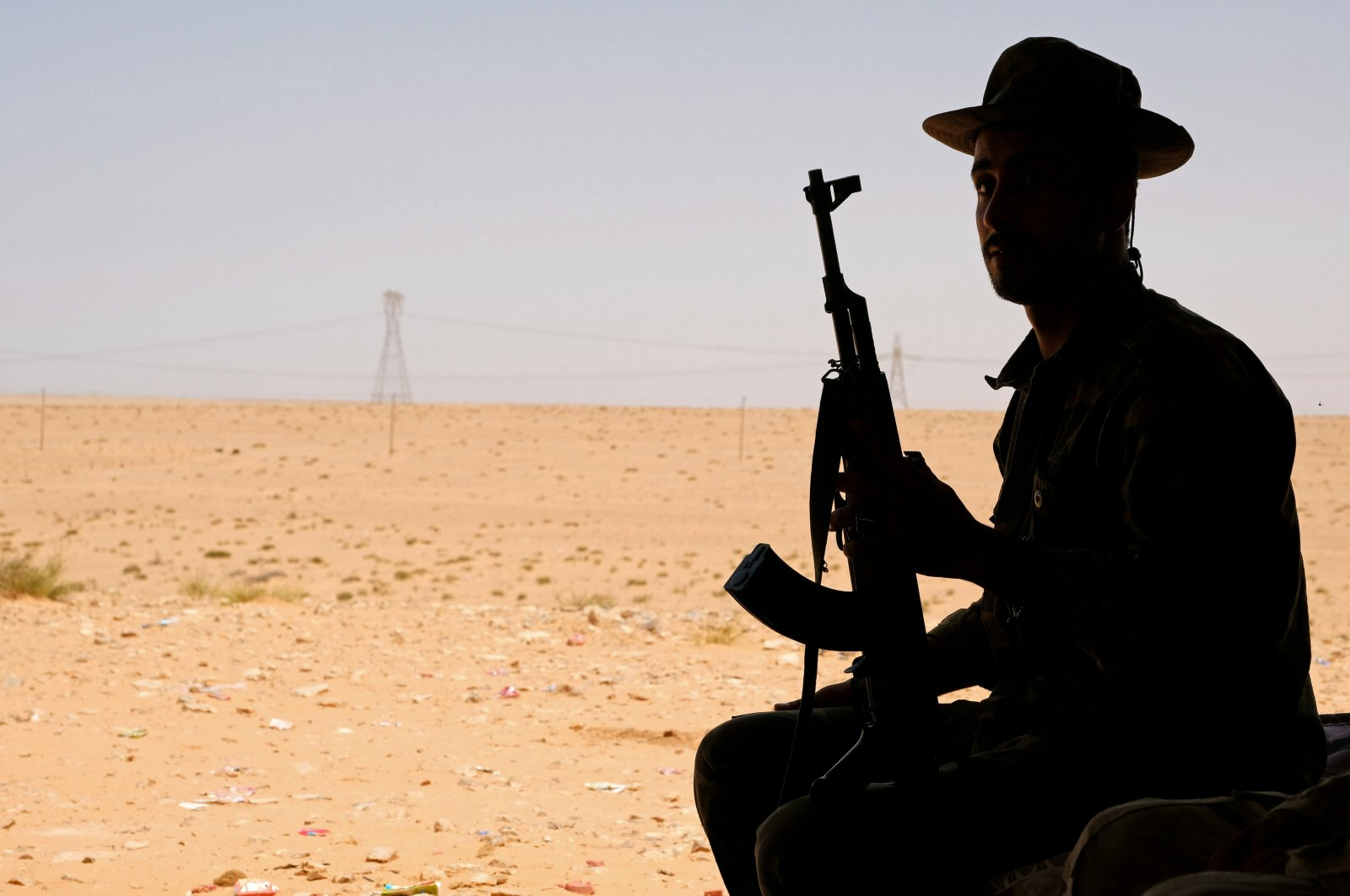 A member of putschist Gen. Khalifa Haftar's army sits in a tent at one of their sites in the west of Sirte, Libya, Aug. 19, 2020. (REUTERS Photo)