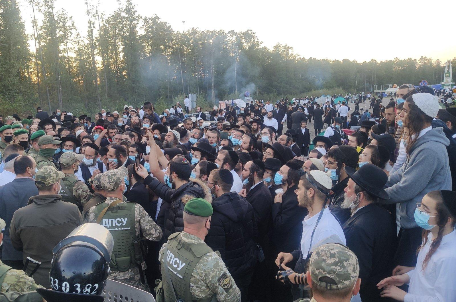 Jewish pilgrims are stuck between Ukrainian and Belarusian border crossings, Sept. 16, 2020. (Ukraine border guard service Photo via AFP)