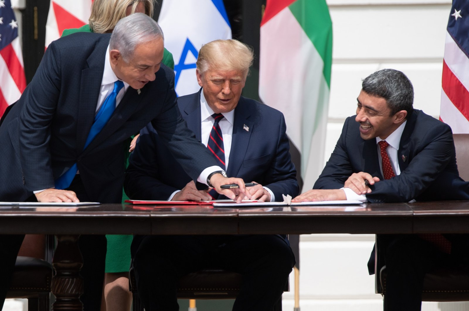 Israeli Prime Minister Benjamin Netanyahu (L), U.S. President Donald Trump, and UAE Foreign Minister Abdullah bin Zayed Al-Nahyan (R) smile as they participate in the signing of the Abraham Accords where the countries of Bahrain and the UAE recognize Israel, at the White House in Washington, D.C., Sept. 15, 2020. (AFP Photo)