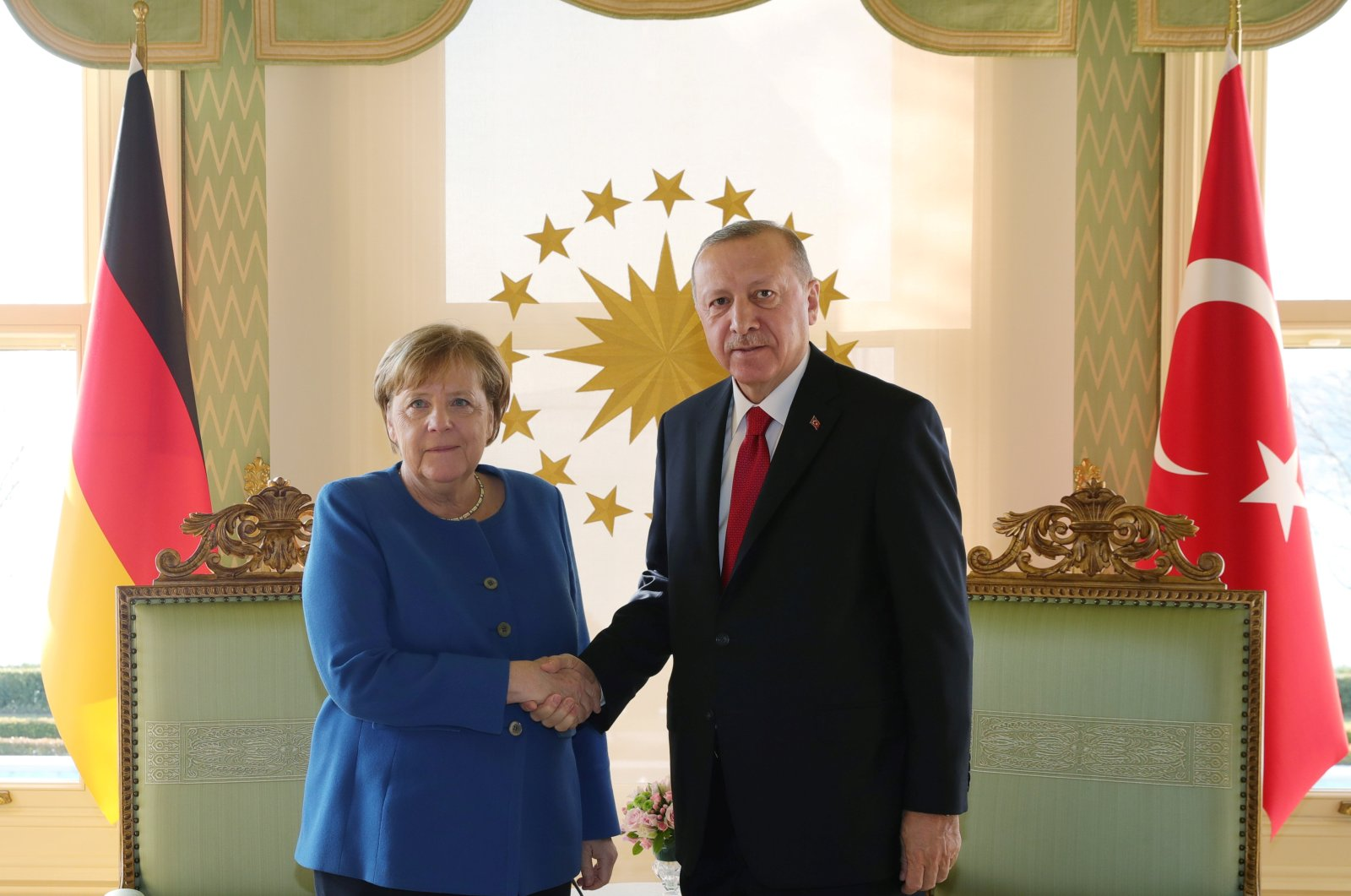 German Chancellor Angela Merkel shakes hands with President Tayyip Erdoğan during their meeting in Istanbul, Turkey, Jan. 24, 2020. (Reuters Photo)