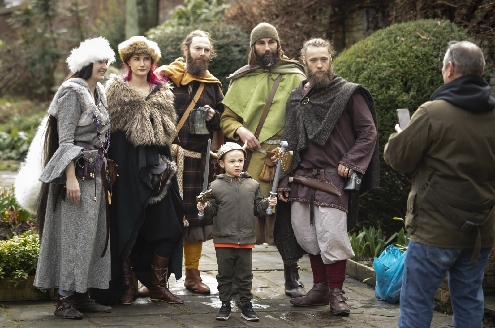 George Nuttall has his photograph taken with Viking re-enactors during the Jorvik Viking Festival in York, recognized as the largest event of its kind in Europe, Feb. 23, 2020. (Reuters Photo)