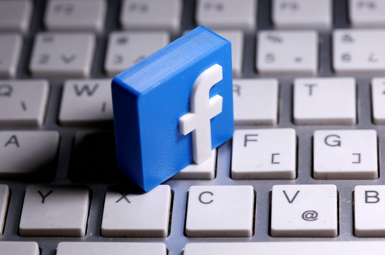 A 3D-printed Facebook logo is seen placed on a keyboard in this illustration taken March 25, 2020. (Reuters Photo)
