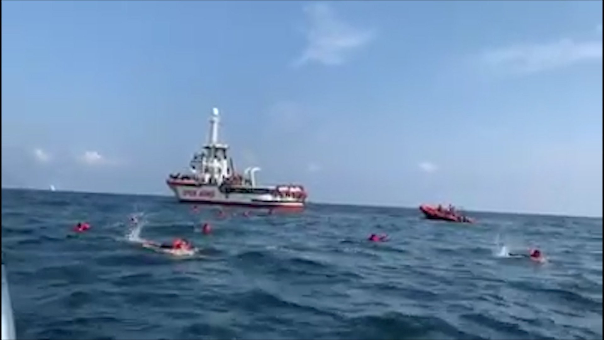 A still image taken from video shows migrants swimming away from Spanish rescue ship Open Arms after jumping overboard in an attempt to reach the coast near Palermo, Italy, Sept. 17, 2020. (Reuters Photo)