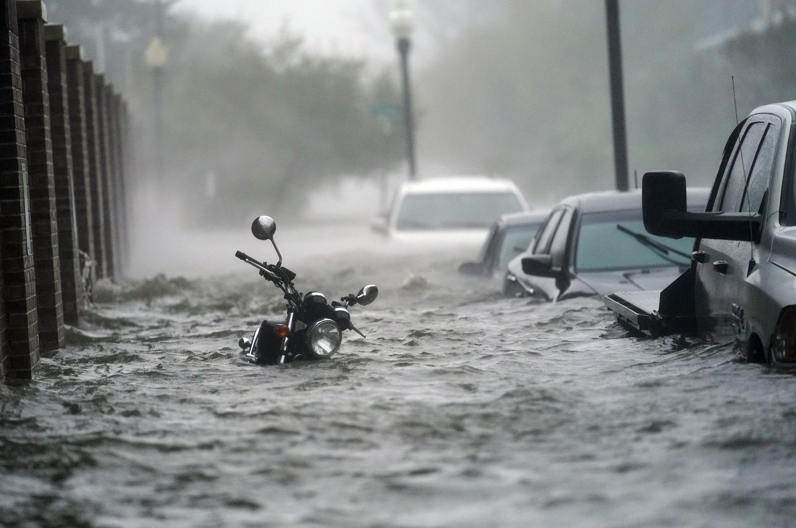 Floodwaters move on the street, Wednesday, Sept. 16, 2020, in Pensacola, Fla. (AP Photo)
