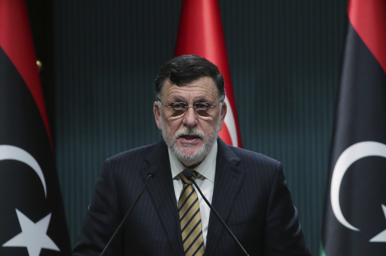 Fayez Sarraj, the head of Libya's internationally recognized government, speaks at a joint news conference with President Recep Tayyip Erdoğan, in Ankara, Turkey, June 4, 2020. (Turkish Presidency via AP)
