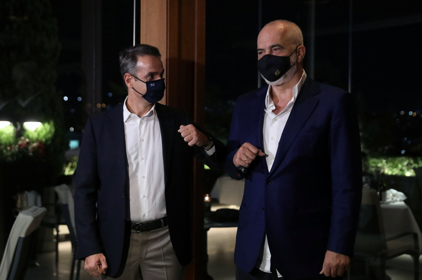 Greek Prime Minister Kyriakos Mitsotakis greets his Albanian counterpart Edi Rama before a working dinner in Athens, Greece, Sept. 15, 2020. (Reuters Photo)