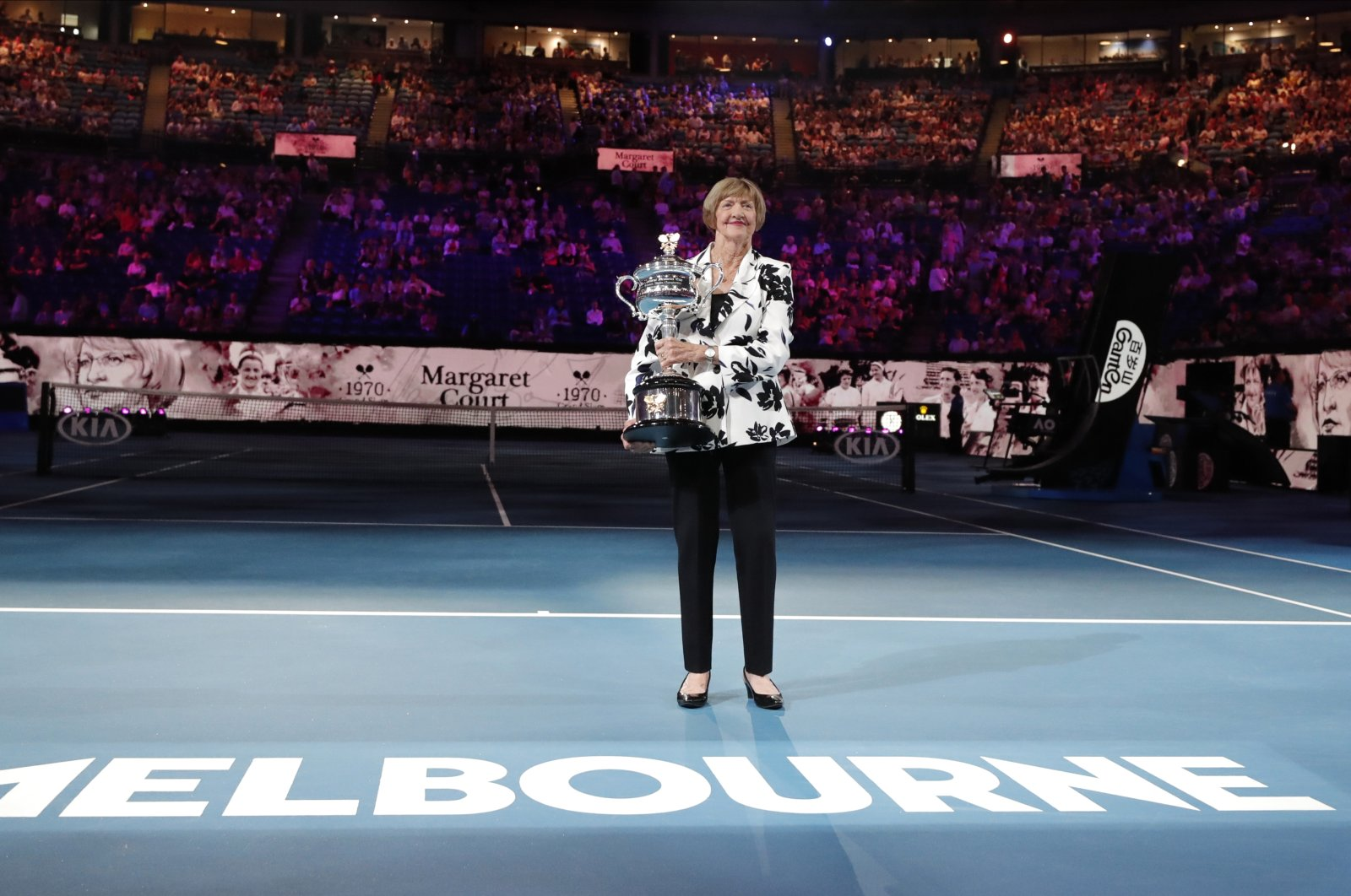 Margaret Court holds up the women's Australian Open trophy as her 50th anniversary of her Grand Slam is celebrated at the Australian Open tennis championship in Melbourne, Australia, Jan. 27, 2020. (AP Photo)