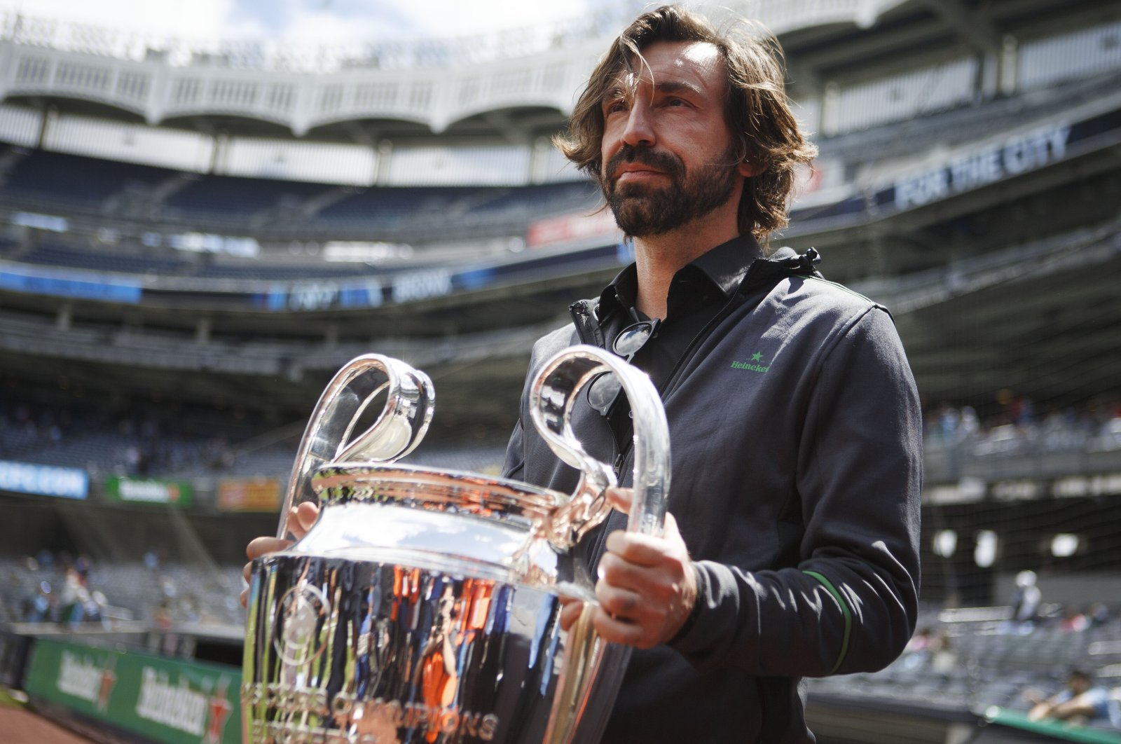 Andrea Pirlo lifts the UEFA Champions League Trophy during a special event held at Yankee Stadium in New York, U.S., Sept. 27, 2019. (AP Photo)
