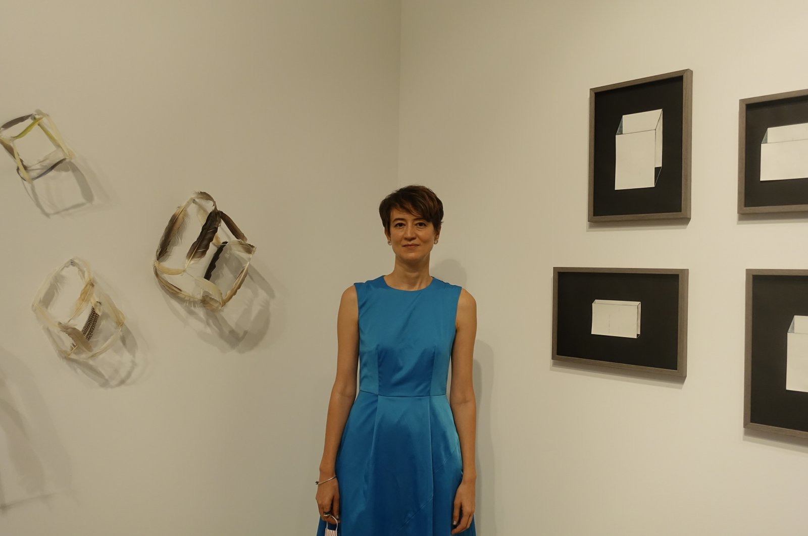 Sena Başöz poses with some of her works at the exhibition at KRANK Art Gallery, Istanbul, Turkey, Sept. 12, 2020. (AA Photo)