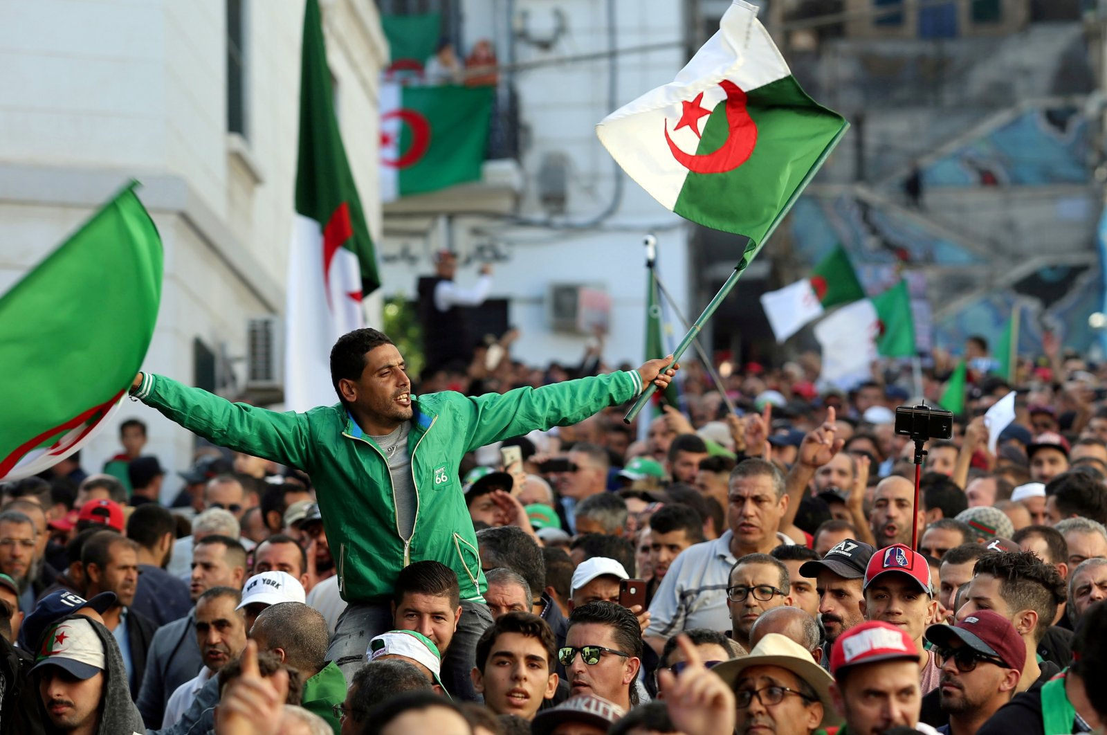 Demonstrators carry national flags during a protest in the capital Algiers, Algeria, Oct. 25, 2019. (REUTERS Photo)
