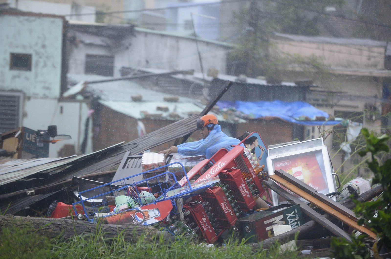 A man sorts through the remains of his home, which collapsed because of Typhoon Nari, in Danang, Vietnam, Oct. 15, 2013. (Reuters Photo)