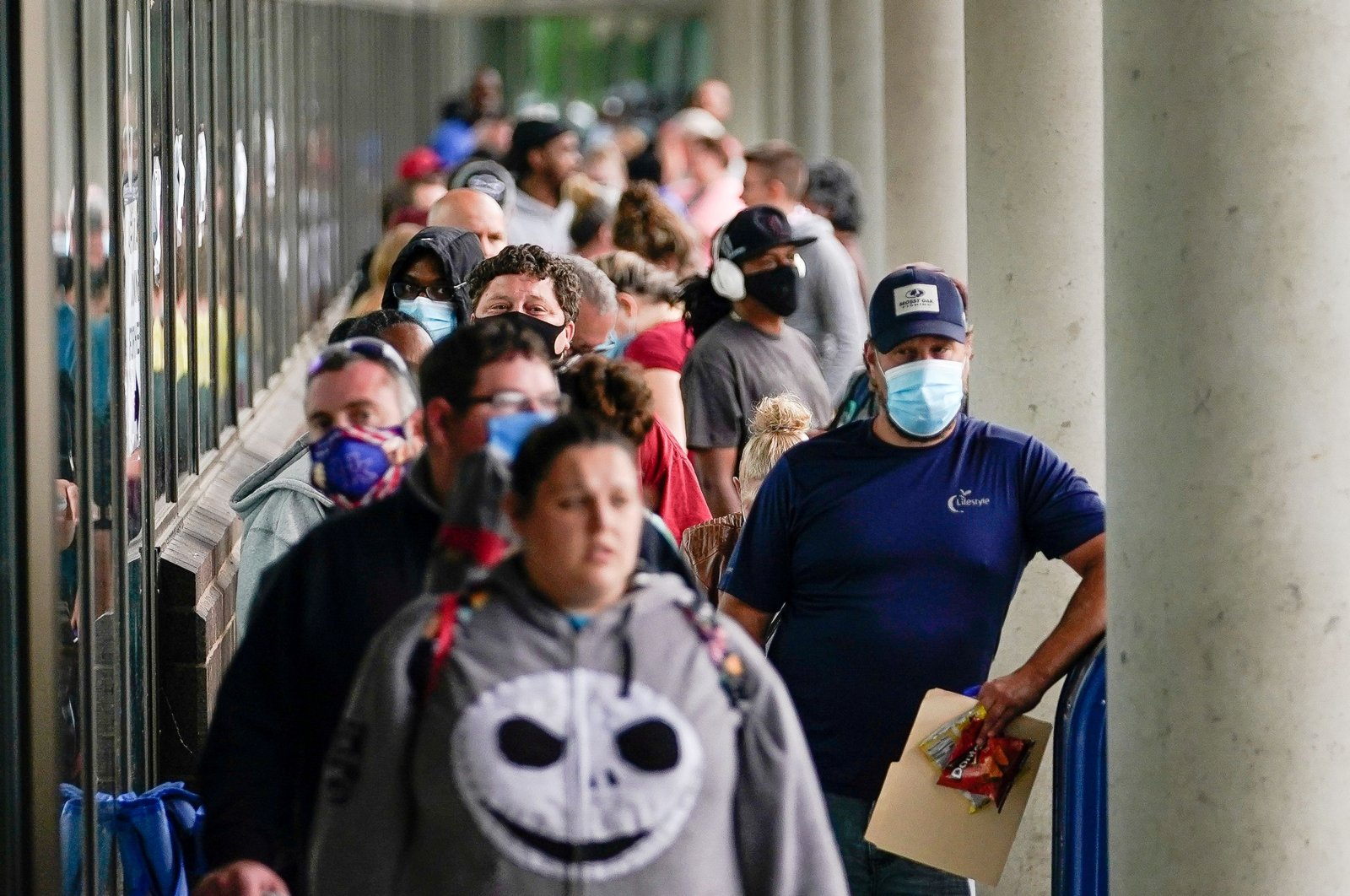 Hundreds of people line up outside a Kentucky Career Center hoping to find assistance with their unemployment claim in Frankfort, Kentucky, U.S., June 18, 2020. (Reuters Photo)