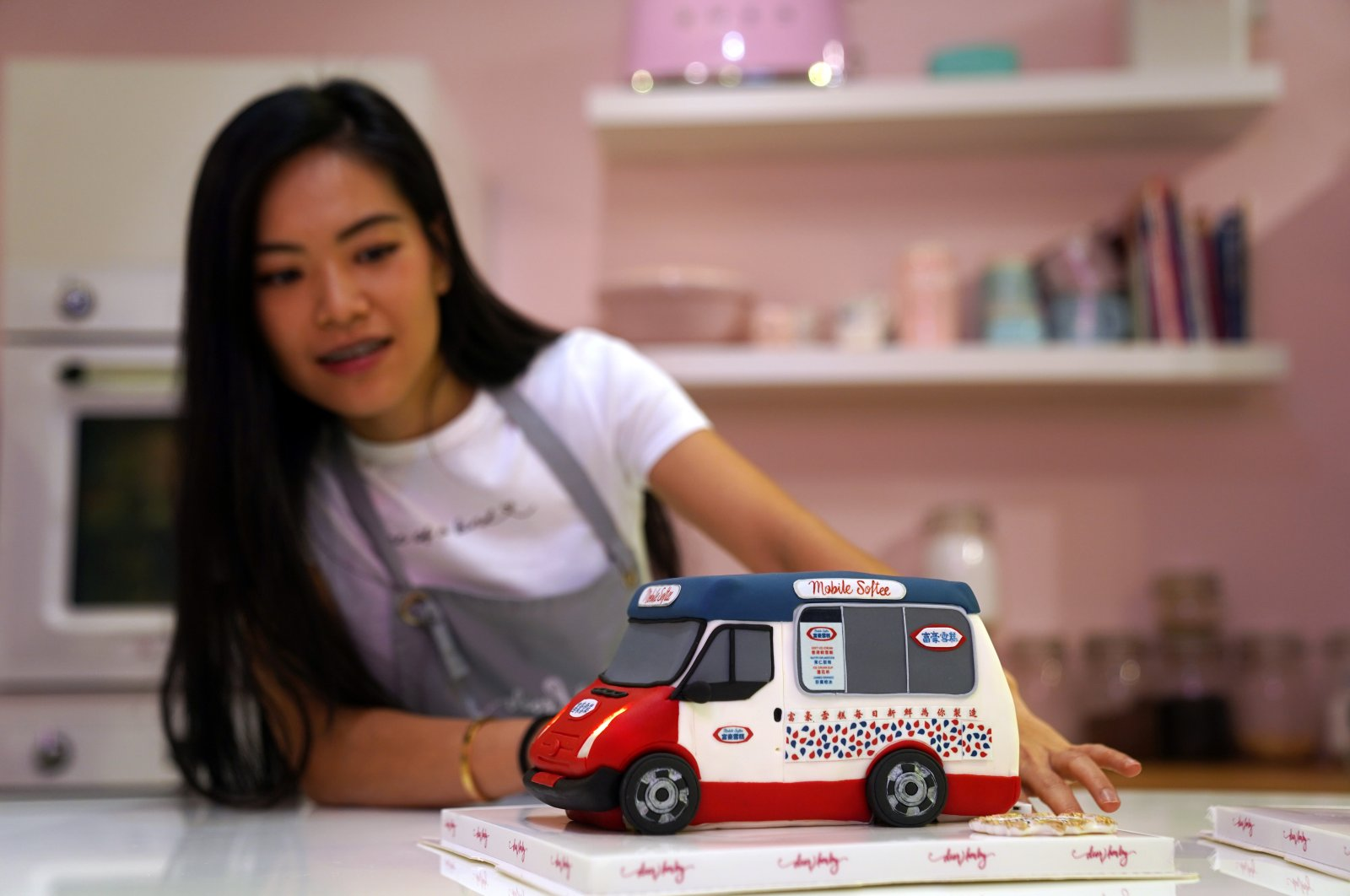 Alison Chan, co-owner of Dear Harley Cake Studio, shows one of the illusion cakes designed to look like a local mobile ice cream truck at the studio in Hong Kong, China, Aug. 25, 2020. (Reuters Photo)