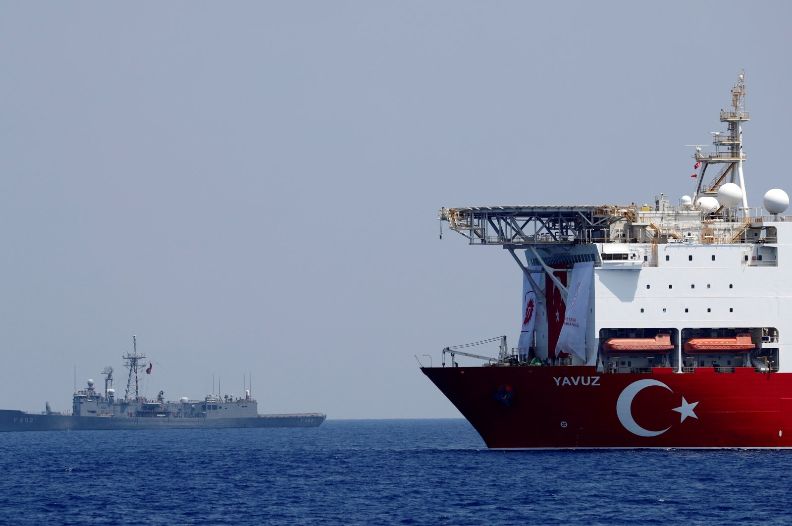 The Turkish drilling vessel Yavuz is seen being escorted by a Turkish Navy frigate in the Eastern Mediterranean, Aug. 6, 2019. (REUTERS)