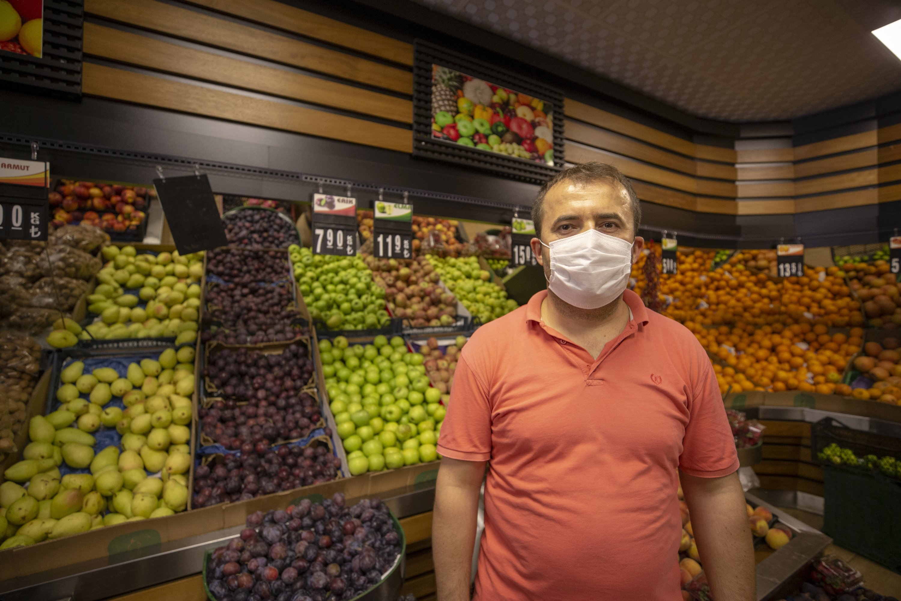 Greengrocer Hüseyin Uçar stands in front of his produce, in Kaş, Antalya province, southern Turkey, Sept. 18, 2020. (AA Photo)