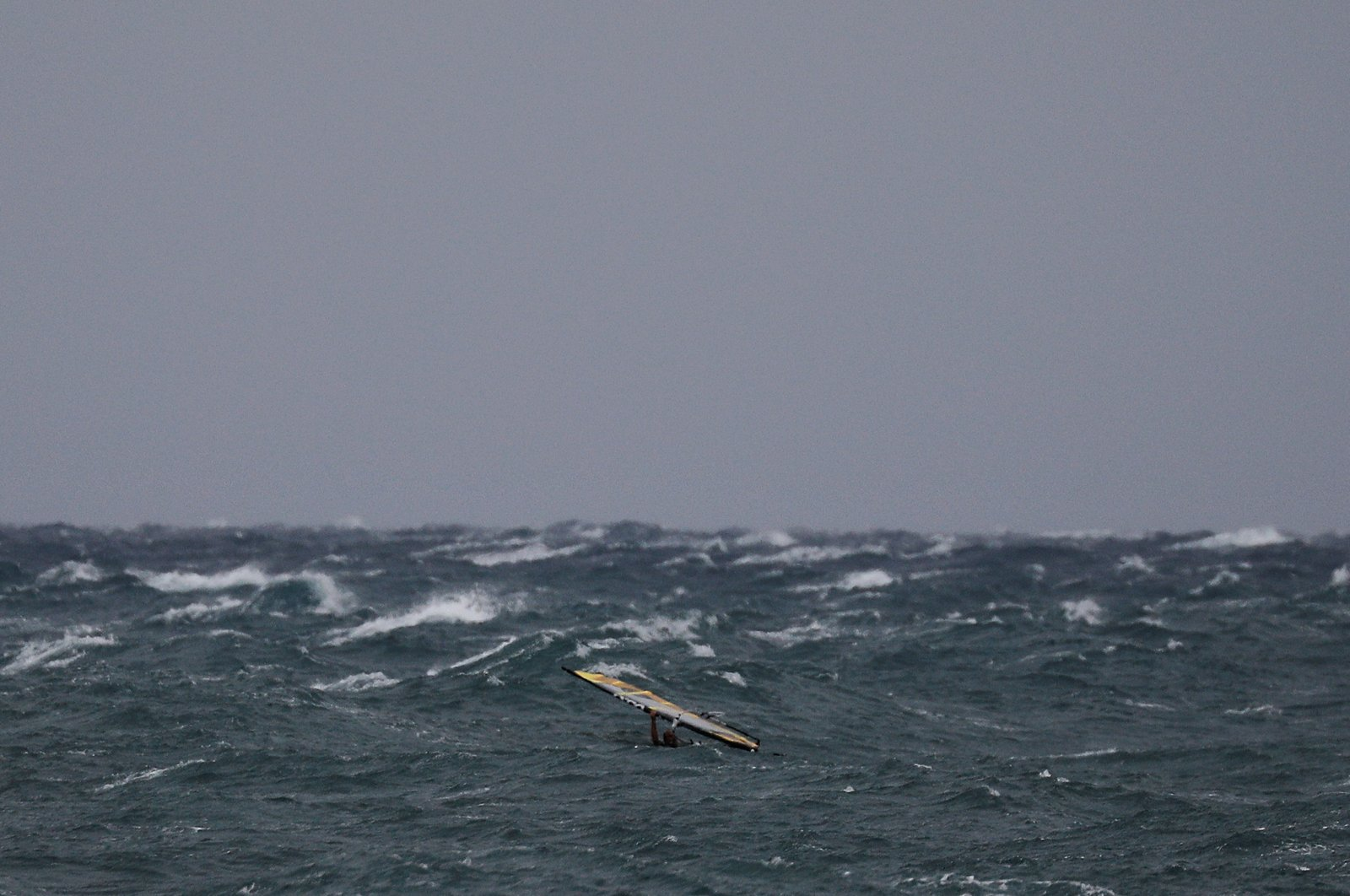 A windsurfer tries to stand on his board as strong winds hit the port town of Rafina, near Athens, Greece, Sept. 27, 2018. (Reuters Photo)