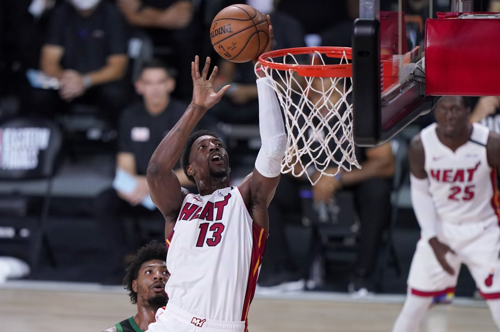 Miami Heat forward Bam Adebayo (13) goes up for a shot after getting past Boston Celtics guard Marcus Smart during an NBA conference final playoff game, in Lake Buena Vista, Florida, U.S., Sept. 17, 2020. (AP Photo)