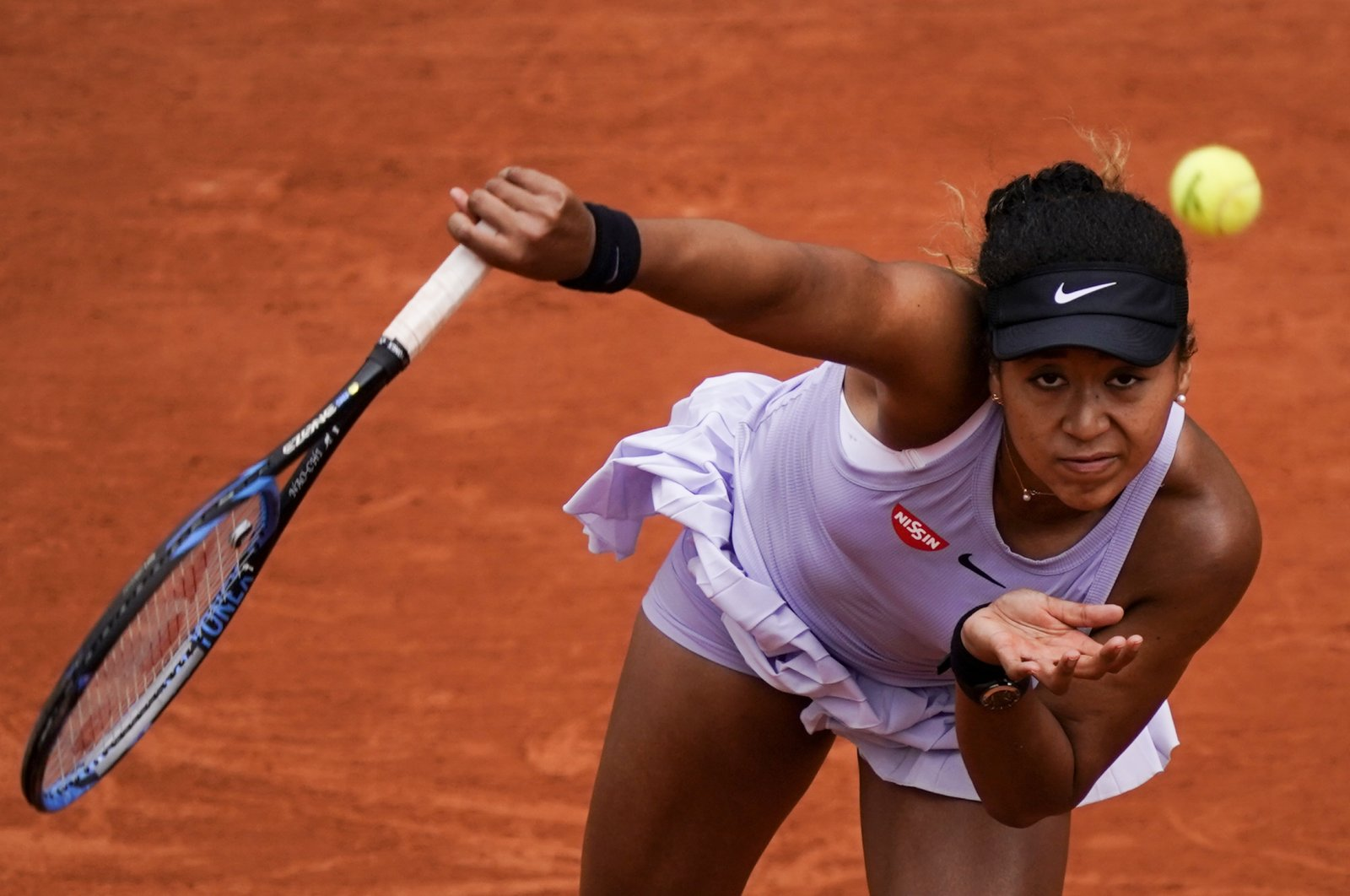 Naomi Osaka serving during a French Open match in Paris, France, May 30, 2019. (AFP Photo)