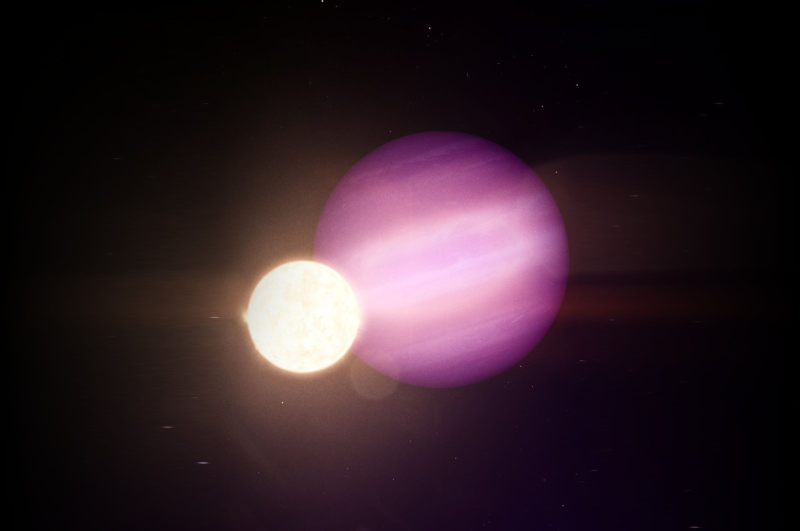 A handout photo made available by NASA shows an artist's impression of WD 1856 b, a potential Jupiter-size planet, orbiting its much smaller host star, a dim white dwarf, issued Sept. 17, 2020. (NASA Goddard Space Flight Center via EPA)
