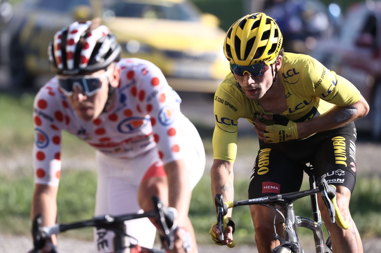 Team UAE rider Tadej Pogacar (L) and Team Jumbo rider Primoz Roglic ride on the Glieres plateau during the 18th stage of the Tour de France cycling race, near Roche sur Foron, France, Sept. 17, 2020. (AFP Photo)