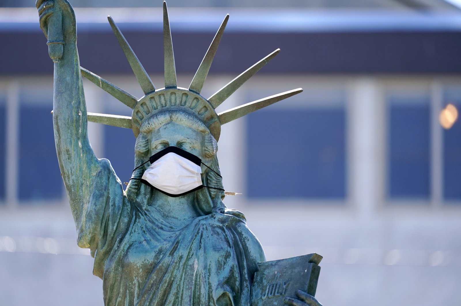 A replica of the Statue of Liberty sports a protective face mask against the coronavirus, in Seattle, Washington, U.S., Aug. 26, 2020. (AP Photo)