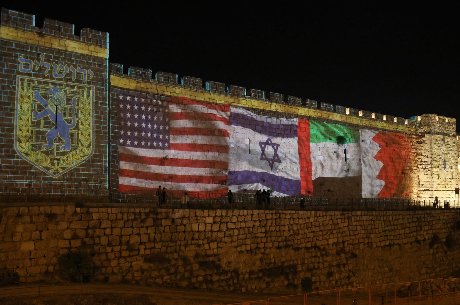 The flags of the U.S., Israel, the United Arab Emirates and Bahrain are projected on the ramparts of Jerusalem's Old City, in a show of support for Israeli deals with the UAE and Bahrain, Sept. 15, 2020. (AFP Photo)