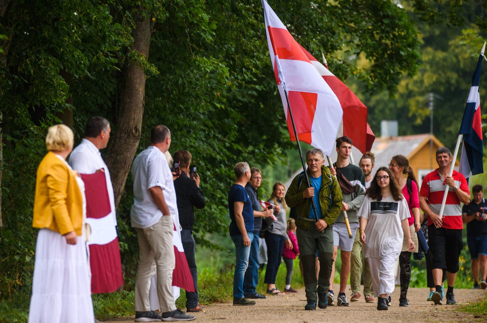 People take part in a solidarity campaign for Belarusian people along the border with Belarus in Piedruja, Latvia, Aug. 23, 2020. (AFP Photo)