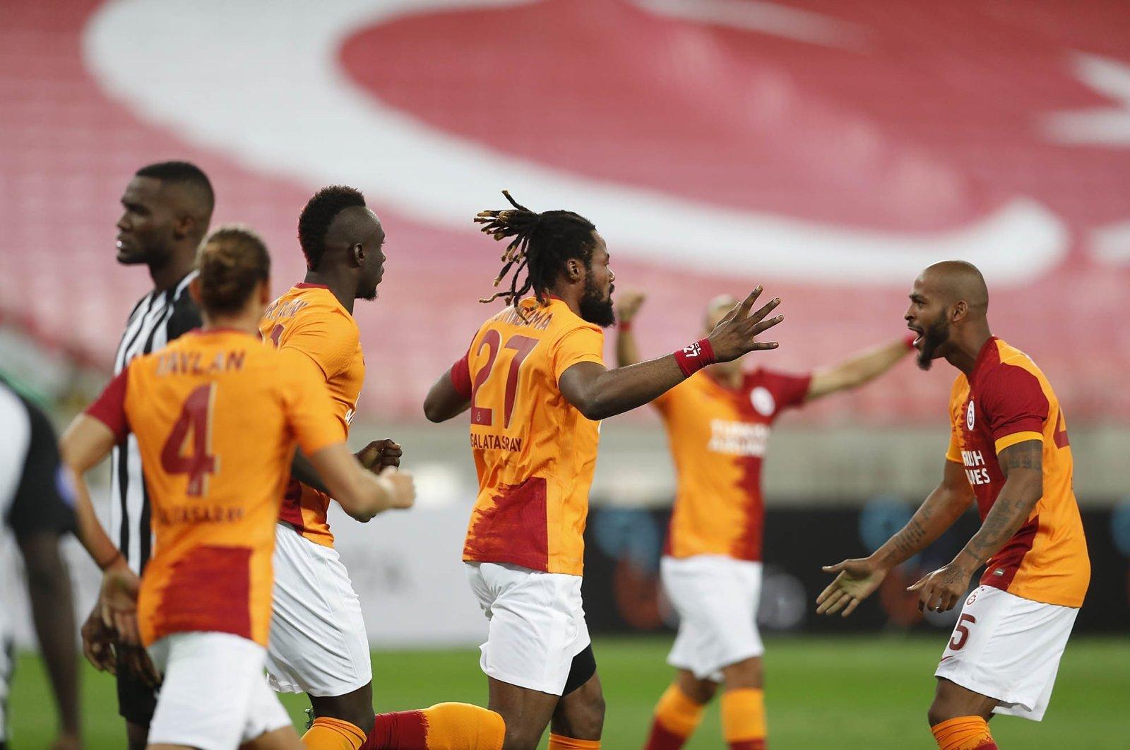 Galatasaray players celebrate a goal during a Europa League qualifier match against Neftçi in Baku, Azerbaijan, Sept. 17, 2020. (IHA Photo)