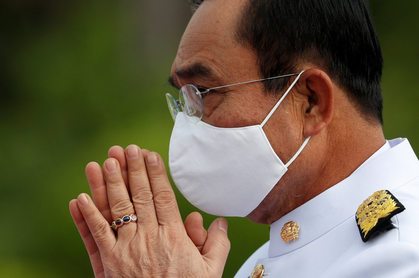 Thailand's Prime Minister Prayuth Chan-ocha, wearing a face mask, attends a family photo session with new cabinet ministers at the Government House in Bangkok, Thailand, Aug. 13, 2020. (Reuters Photo)