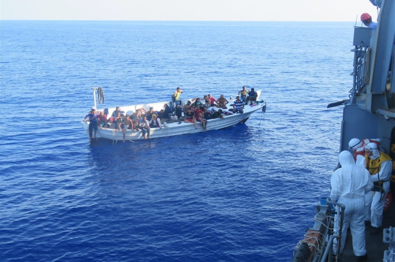 Thirty-six irregular migrants were rescued by the personnel of TCG Bozcaada corvette, which is on a mission as part of the United Nations Interim Force in Lebanon (UNIFIL), in the Mediterranean Sea, Sept. 15, 2020. (AA Photo)