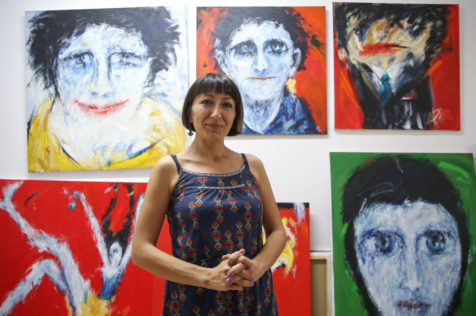 Artist Deniz Karakurt Şekerci poses with some of her works at her workshop, Antalya, southern Turkey, Sept. 17, 2020. (AA Photo)