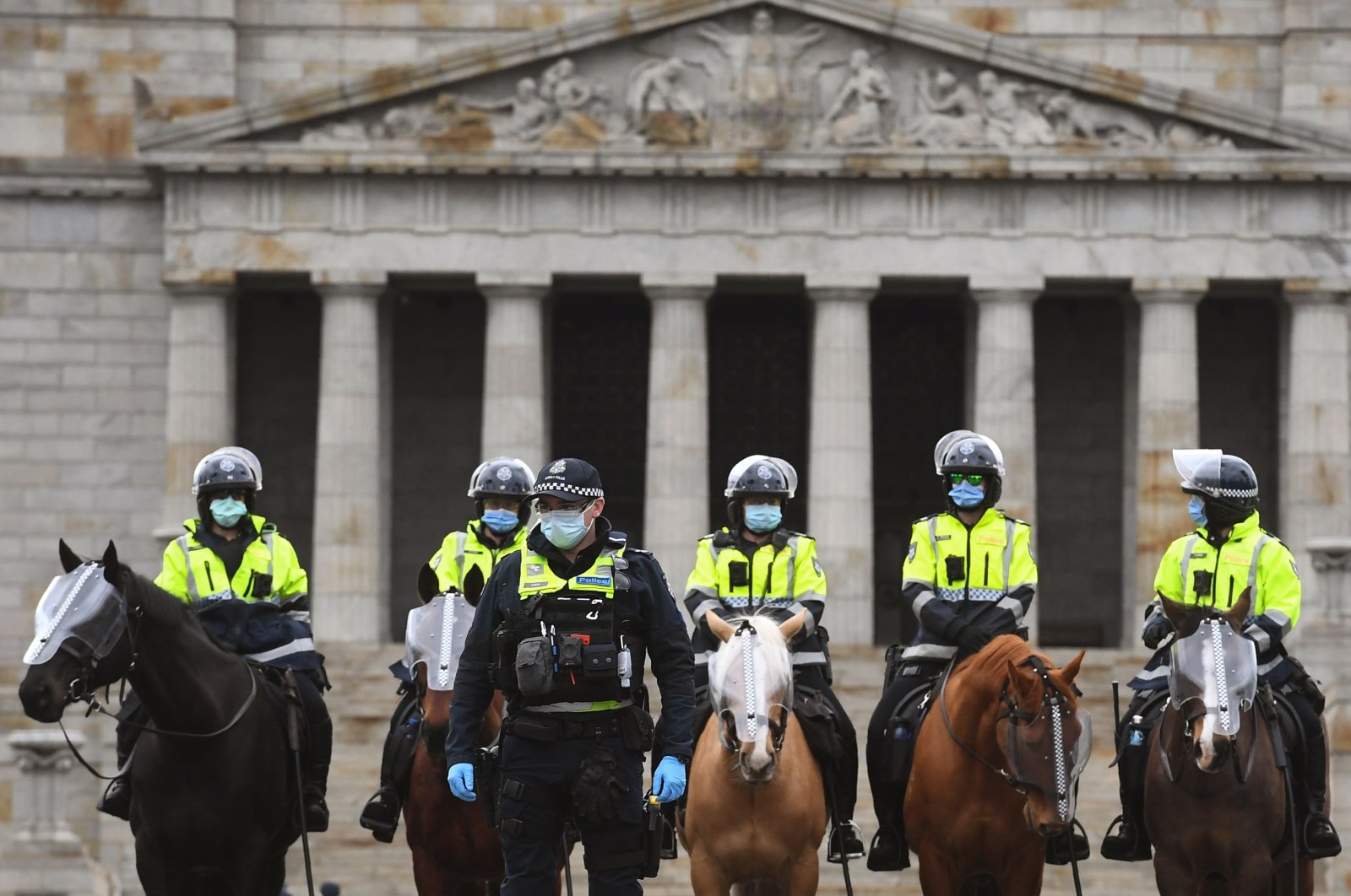 Police stand guard in front of the Shrine of Remembrance during an anti-lockdown rally, Melbourne, Australia, Sept. 12, 2020. (AFP Photo)