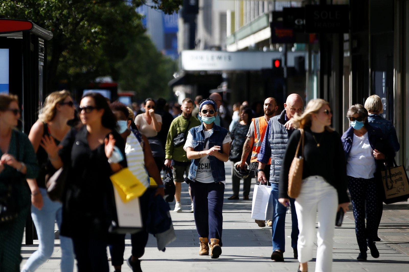 Pedestrians walk along Oxford Street, London, Sept. 17, 2020. (REUTERS Photo)