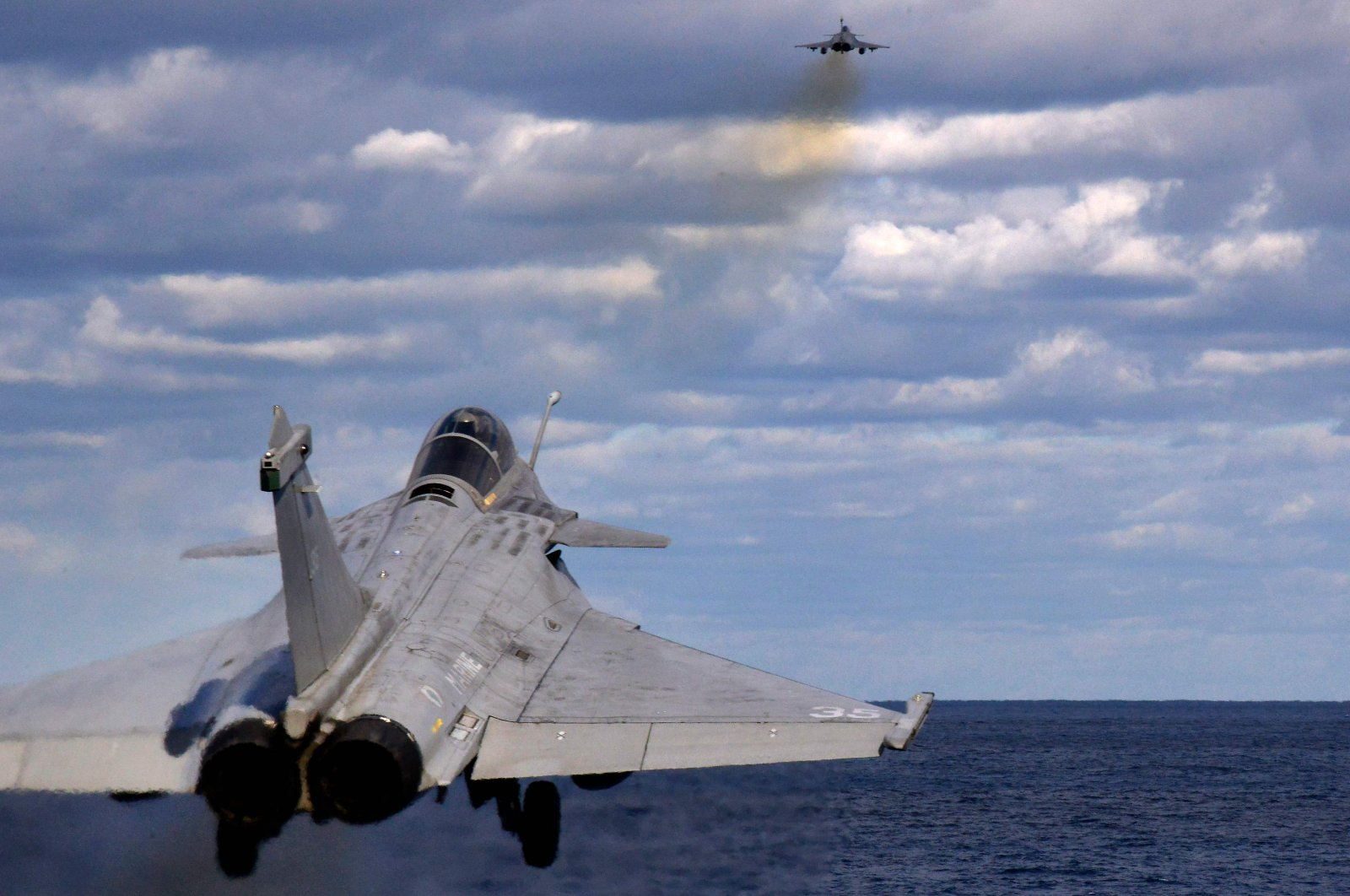 Two French Rafale fighter jets are catapulted from the French aircraft carrier, Charles de Gaulle, off the eastern coast of Cyprus in the Mediterranean Sea, Feb. 10, 2020. (AFP Photo)
