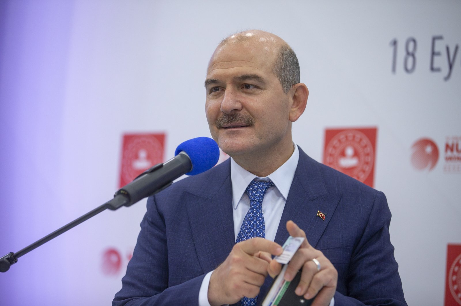"""Interior Minister Süleyman Soylu shows his ID card as he explains the details of """"Your Life is Easier with Your ID"""" project in a press conference in Ankara, Turkey, Sept. 18, 2020. (AA Photo)"""