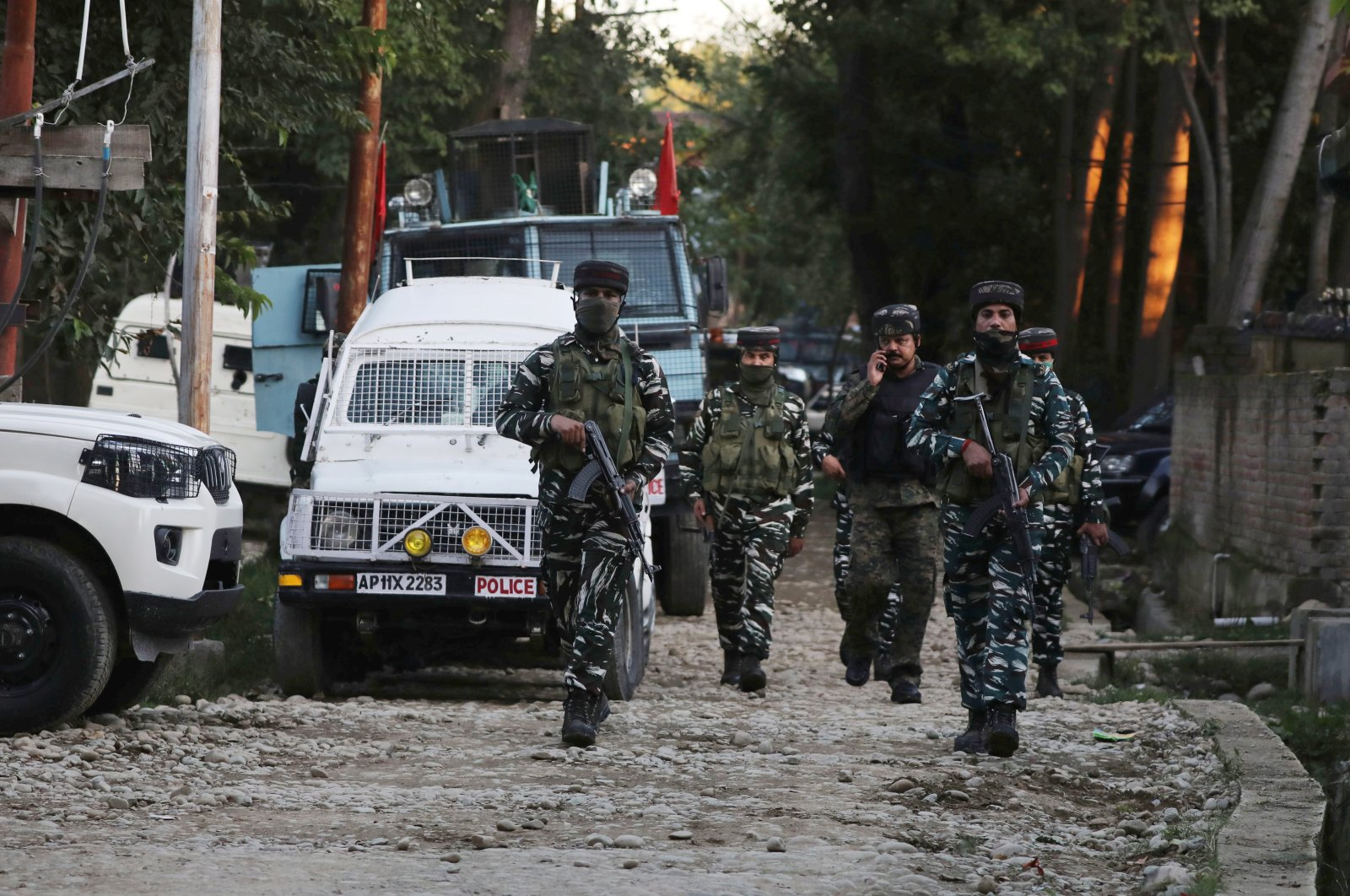 Indian security personnel walk near the site of a gunfight in a village in Kawoosa area of central Kashmir's Budgam district, some 20 kilometers from Srinagar, the summer capital of Indian Kashmir, Sept. 7, 2020. (EPA Photo)