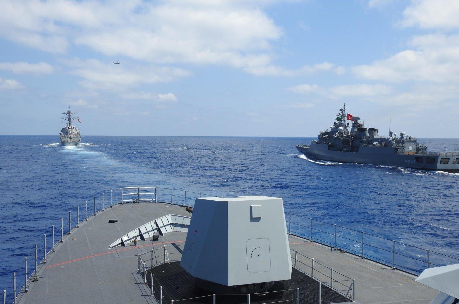 Turkey's TCG Barbaros frigate and TCG Burgazada corvette sail during a drill in Eastern Mediterranean on Aug. 26, 2020 (AA Photo)