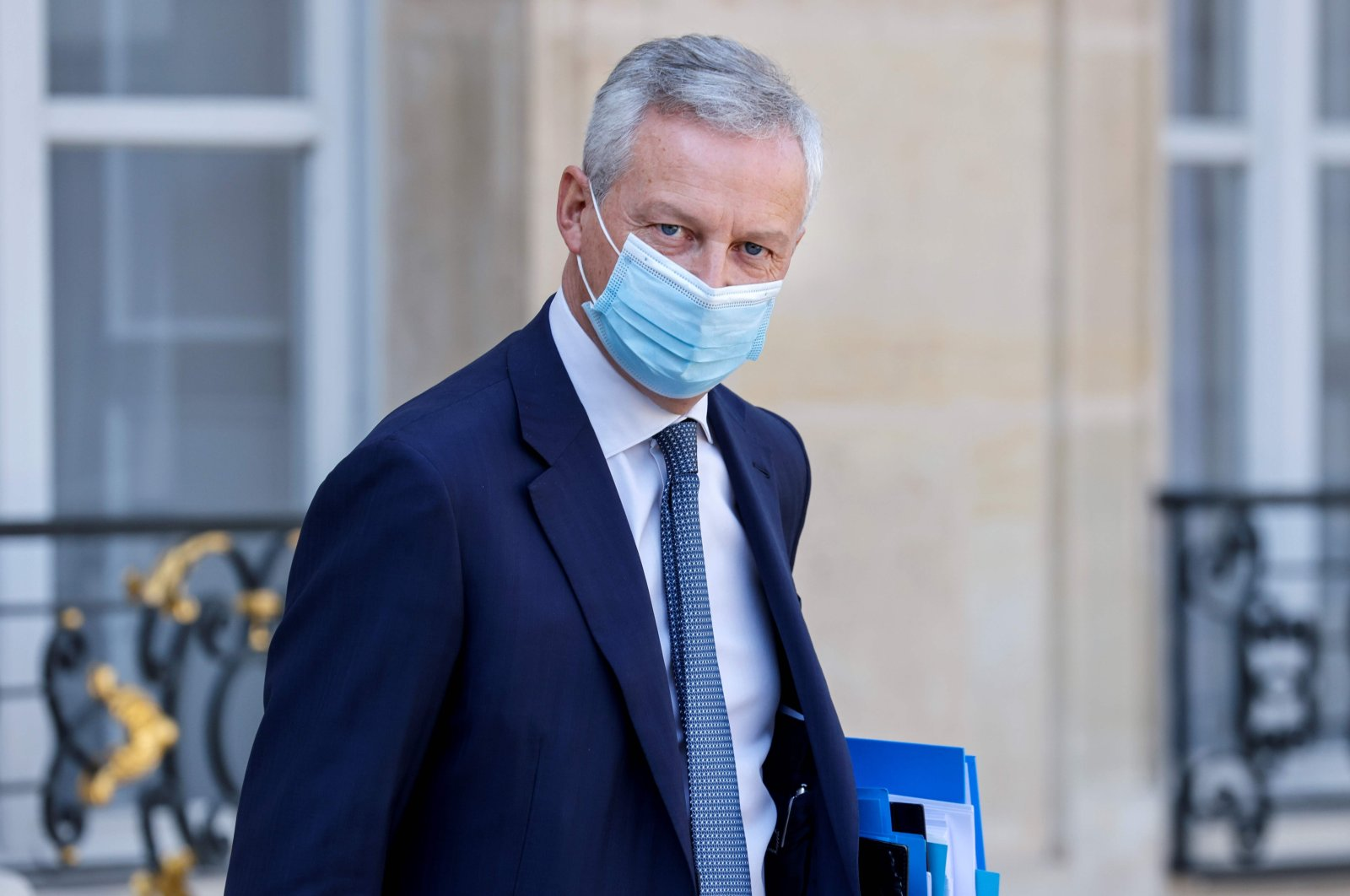French Economy and Finance Minister Bruno Le Maire, wearing a face mask, leaves after the weekly cabinet meeting at the Elysee Palace in Paris, Sept 16, 2020. (AFP Photo)