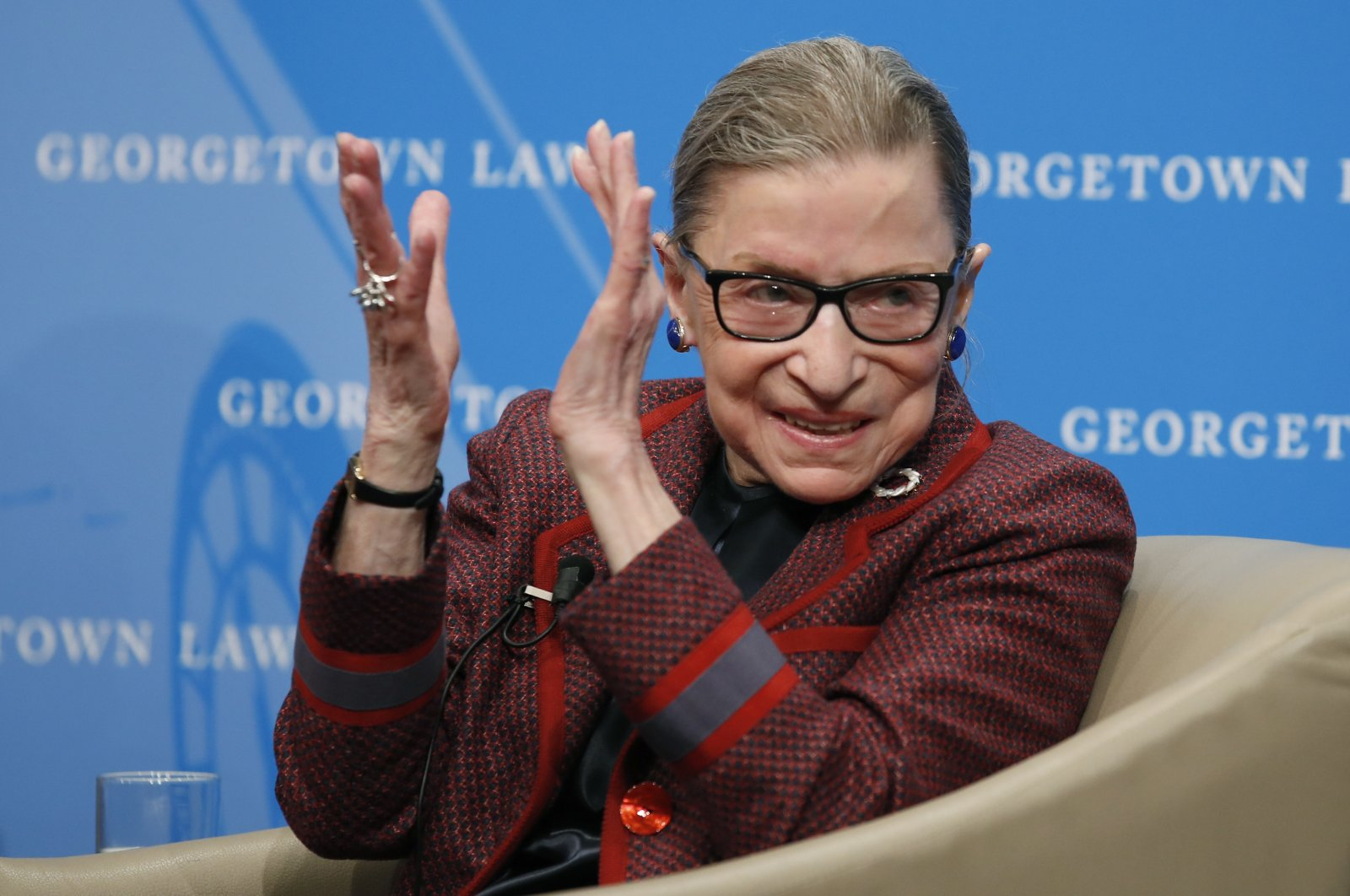 In this April 6, 2018, file photo, Supreme Court Justice Ruth Bader Ginsburg applauds after a performance in her honor after she spoke about her life and work during a discussion at Georgetown Law School in Washington. (AP Photo)