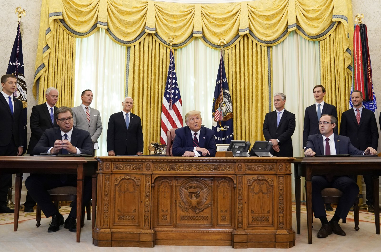 U.S. President Donald Trump (C) speaks after participating in a signing ceremony with Serbian President Aleksandar Vucic (L) and Kosovar Prime Minister Avdullah Hoti in the Oval Office of the White House, Friday, Sept. 4, 2020, in Washington. (AP Photo)