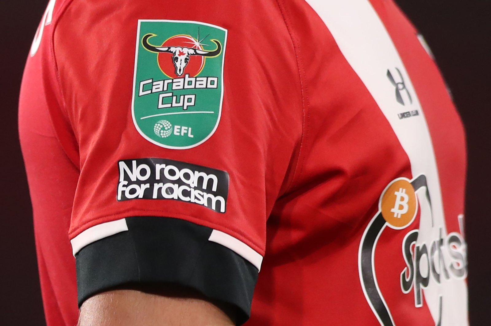 """An anti-racism slogan reading """"No Room For Racism"""" on the sleeve of Southampton's English defender Jack Stephens during the English League Cup second round football match between Southampton and Brentford at St. Mary's Stadium in Southampton, southern England on Sept. 16, 2020. (AFP Photo)"""