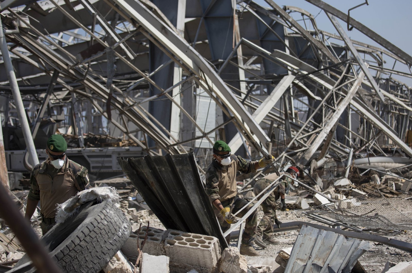 French soldiers clear debris as they work with Lebanese soldiers at the site of the Aug. 4 deadly blast in the port of Beirut that killed scores and wounded thousands, in Beirut, Lebanon, Wednesday, Aug. 26, 2020. (AP Photo)