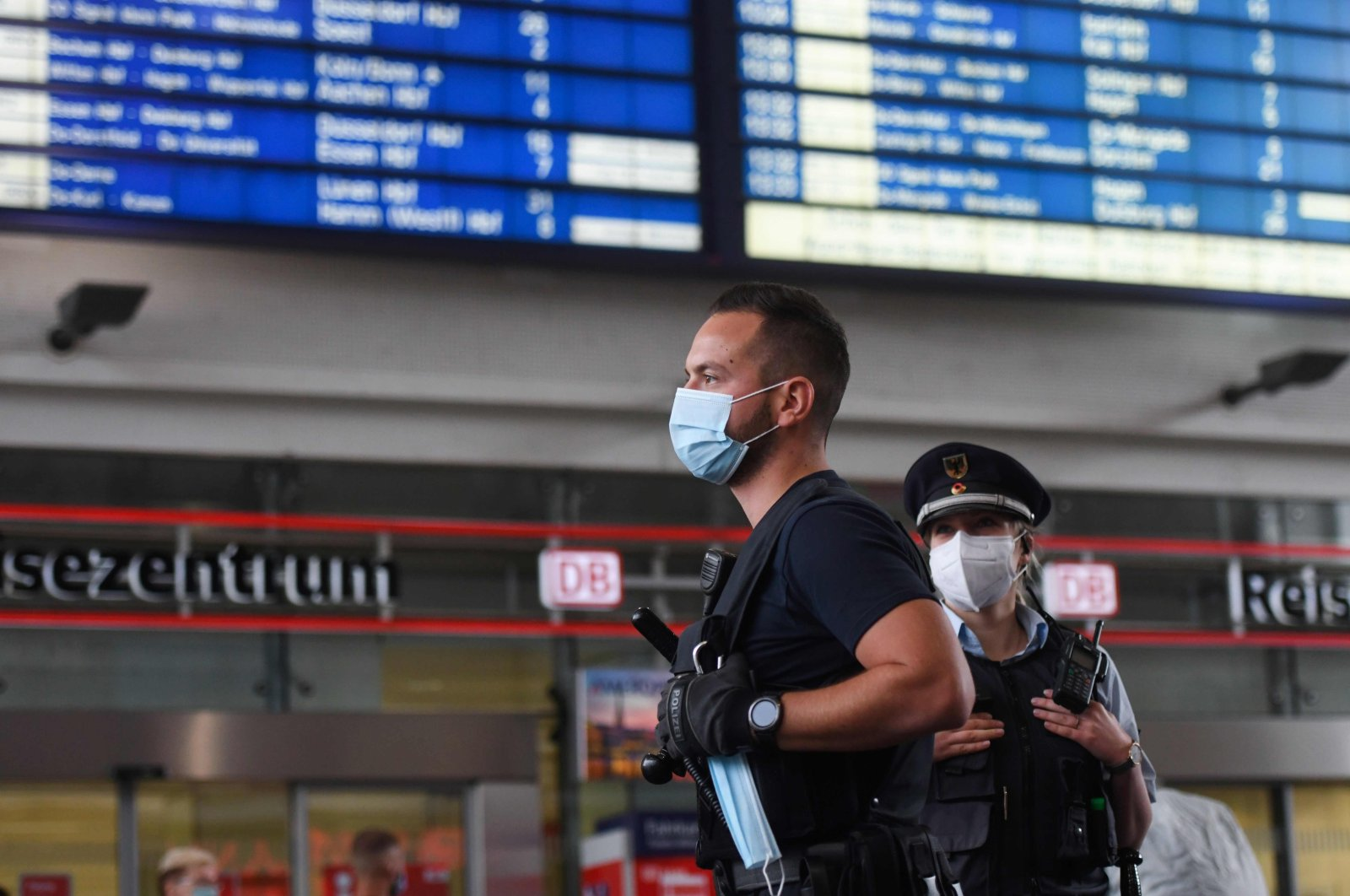 Employees of the public order office and the federal police patrol to control that commuters respect the obligation to wear a mask on August 24, 2020 at the main railway station in Dortmund, western Germany, amid the new coronavirus pandemic. (AFP Photo)