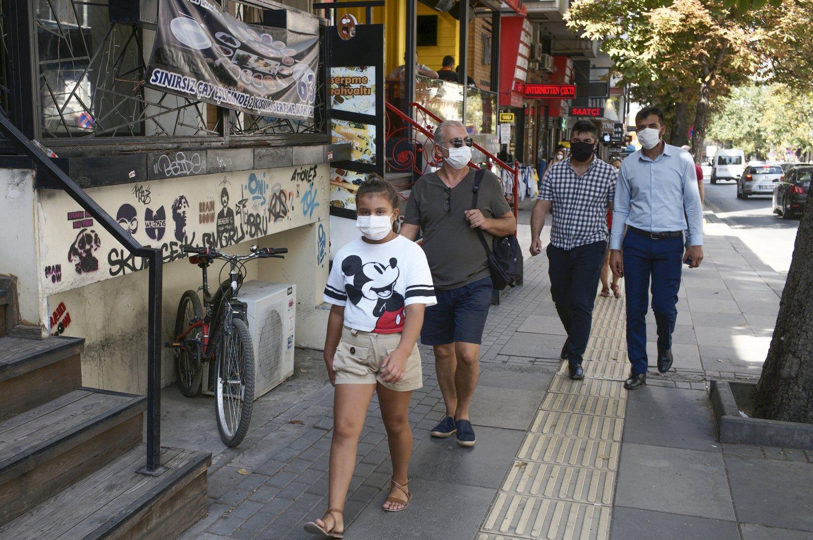 People walk along a street in Ankara, Turkey, Wednesday, Sept. 2, 2020. (AP Photo)