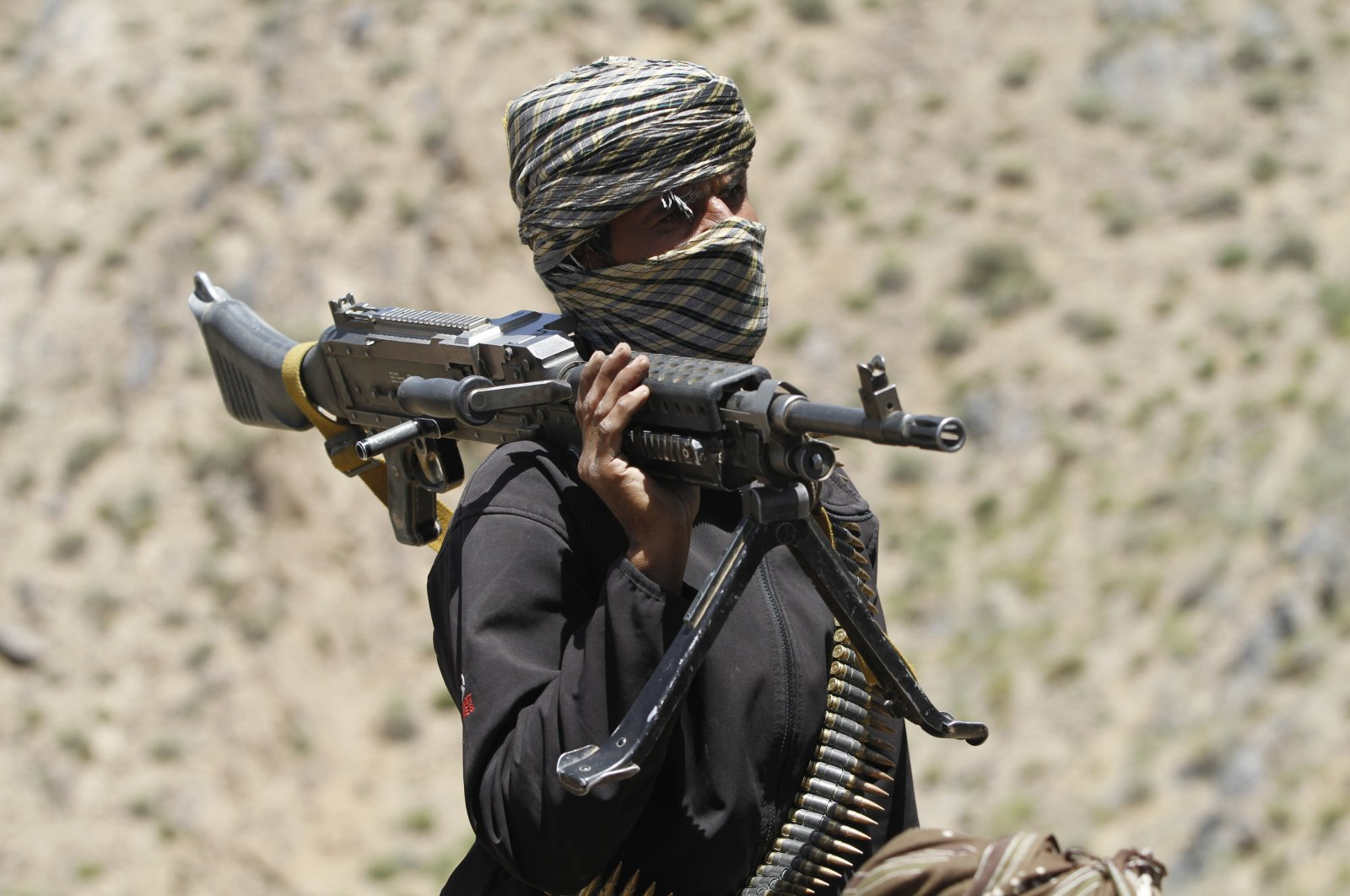 In this May 27, 2016 file photo, a member of a breakaway faction of the Taliban fighters guards a gathering in Shindand district of Herat province, Afghanistan. (AP File Photo)