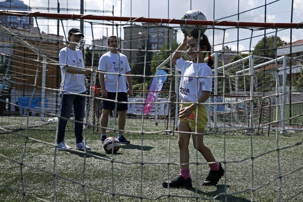 A girl balances a football on her head at a football camp for refugee children organized by Kızlar Sahada in Istanbul, Turkey, in 2018. (Photo courtesy of Kızlar Sahada)