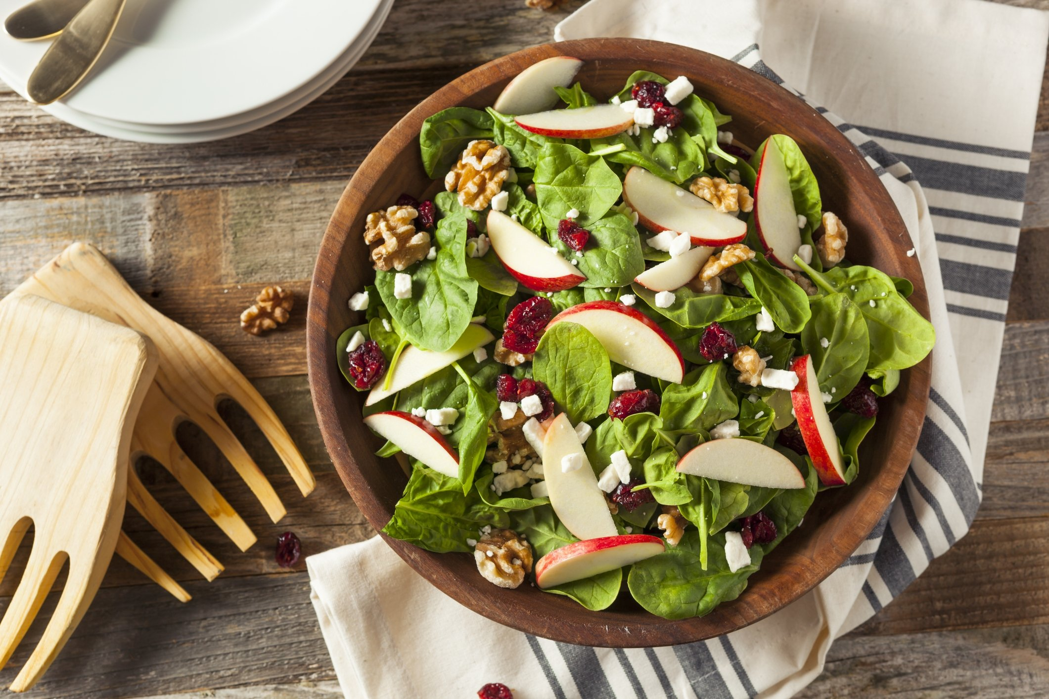 For a real fall salad, add toss some apples with spinach, walnuts and cheese. (iStock Photo)